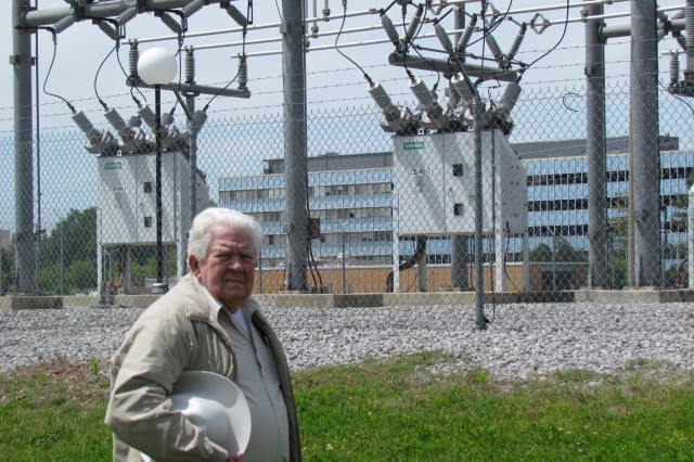 Electrical engineer Arthur Barnette, who works for contractor Chugach, stands in front of Unit Substation 16 at the corner of Fowler and Morris roads. One of the first of the more modern substations here, it was built in 1998.