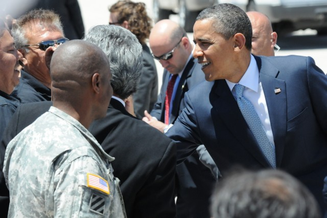 President Barack Obama greets Soldiers and civilians, after arriving on Biggs Army Airfield, El Paso Texas. Obama spoke on immigration and its effect on the economy.