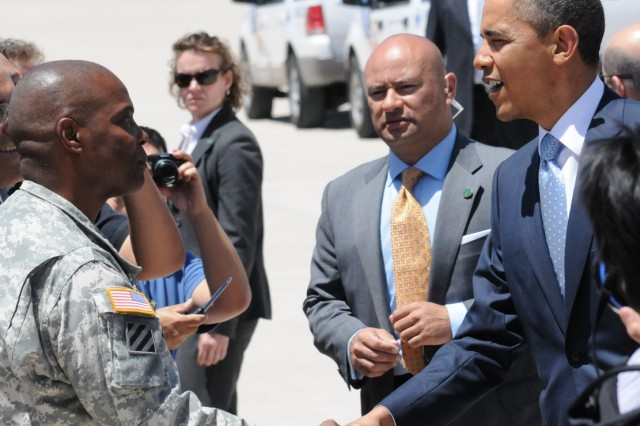President Barack Obama greets Brig. Gen. Stephen M. Twitty, Fort Bliss Deputy Commanding General, after arriving on Biggs Army Airfield, El Paso Texas. Obama spoke on immigration and its effect on the economy.