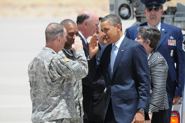 President Barack Obama returns the salute to Command Sgt. Maj. David S. Davenport, Fort Bliss Command Sergeant Major, after arriving on Biggs Army Airfield, El Paso Texas, May 10, 2011. Obama spoke on immigration and its effect on the economy.