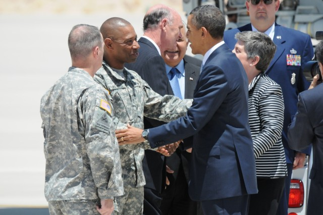 President Barack Obama greets Maj. Gen. Dana J. H. Pittard, Fort Bliss Commanding General, after arriving on Biggs Army Airfield, El Paso Texas, May 10, 2011. Obama spoke on immigration and its effect on the economy.