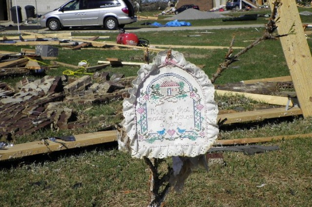Sue Tillery's husband, Jack, left an embroidered napkin which said, 'It's love that makes a house a home' on a single standing branch in what was their Athens home after a F5 tornado hit April 27.