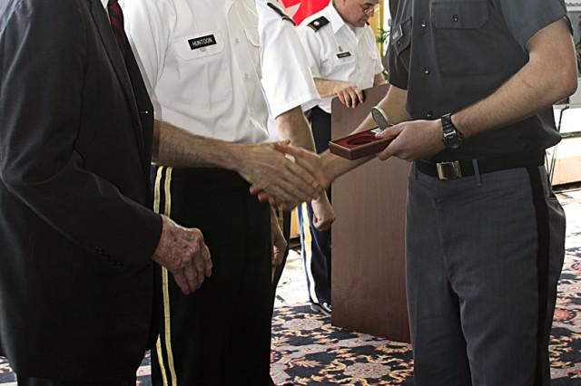 Retired Lt. Gen. John H. Cushman and Lt. Gen. David H. Huntoon Jr., West Point superintendent, congratulate Class of 2011 Cadet Brian McBee, the 2011 gold medallion recipient of the John J. Pershing Reflective Essay competition.