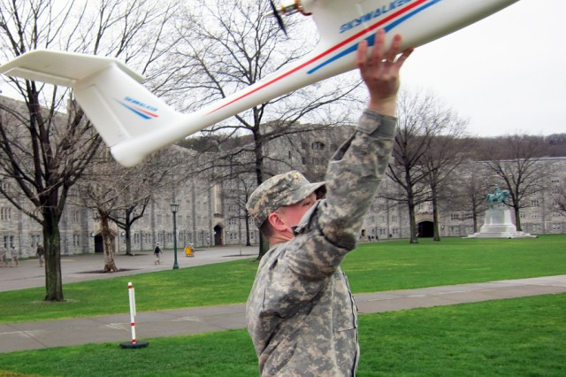 West Point Class of 2011 Cadet James Raub sends the UAV on its way as the team conducts a test on campus.