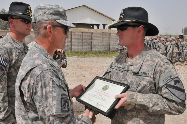 """CONTINGENCY OPERATING SITE MAREZ, Iraq - Maj. Gen. Daniel Allyn, commanding general of 1st Cavalry Division, awards Capt. Ben Jackman, outgoing commander of Headquarters and Headquarters Troop, 1st Squadron, 9th Cavalry Regiment, 4th Advise and Assist Brigade, 1st Cavalry Division, a U.S. Army Accident Prevention Certificate during an awards ceremony at Contingency Operating Site Marez, May 7, 2011. Allyn visited the 4th AAB Soldiers while en route to Afghanistan to thank the """"Long Knife"""" troopers for their hard work and dedication to their mission in northern Iraq."""