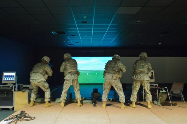 Soldiers complete combat field fire scenarios in the Engagement Skills Trainer 2000.y