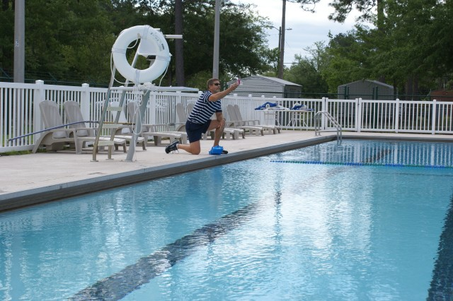 Andy Arrington tests the water at Bryan Village Pool; work is under way to prepare the outdoor pools at Fort Stewart and Hunter Army Airfield for opening day, May 27.