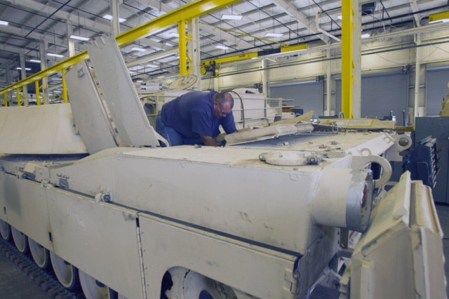 Steven Homesley, an Anniston Army Depot heavy mobile equipment mechanic, disassembles a M1A2 Abrams tank in the Nichols Industrial Complex. This tank will be repaired and upgraded by Anniston Army Depot and General Dynamics Land Systems for the government of Saudi Arabia.