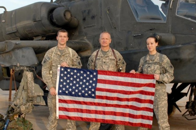 Chief Warrant Officer Brendon McNamara, left, Capt. Dennis McNamara, and Capt. Elizabeth McNamara, are all AH-64 Apache helicopter pilots for the 8-229 Attack Reconnaissance Battalion from Fort Knox, Ky. Dennis is the proud father of Brendon and Elizabeth.