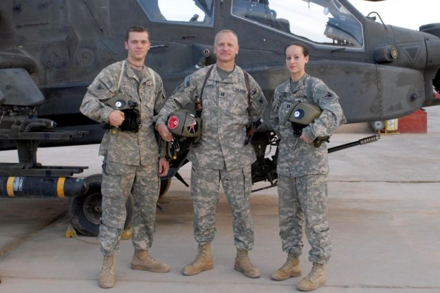Chief Warrant Officer Brendon McNamara, left, Capt. Dennis McNamara, and Capt. Elizabeth McNamara, are all AH-64 Apache helicopter pilots deployed to Camp Taji, Iraq, with the 8-229 Attack Reconnaissance Battalion from Fort Knox, Ky. Dennis is the proud father of Brendon and Elizabeth.