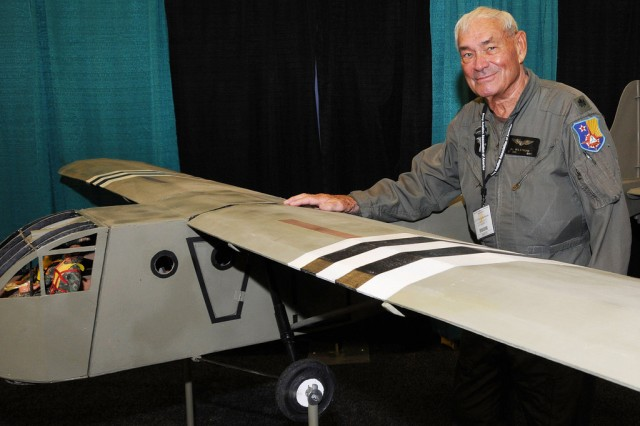 Retired Lt. Col. Al Hulstrunk, WWII glider pilot, stands with a model glider at AAAA in Nashville.