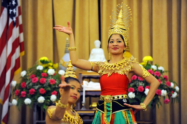 Apinya Saengsililath, right, and Sudawan Carras, both attendees at a Buddhist temple in Auburn, Wash., perform a traditional dance at the Vesak Day celebration May 7, 2011, at Lewis North Chapel on Joint Base Lewis-McChord, Wash. Servicemembers and