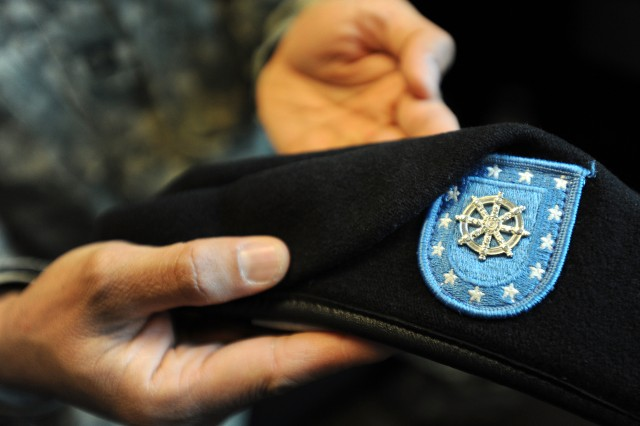 The silver color dharma cakra Buddhist branch insignia on Malasri's beret is among the most uncommon symbols in the U.S. military.