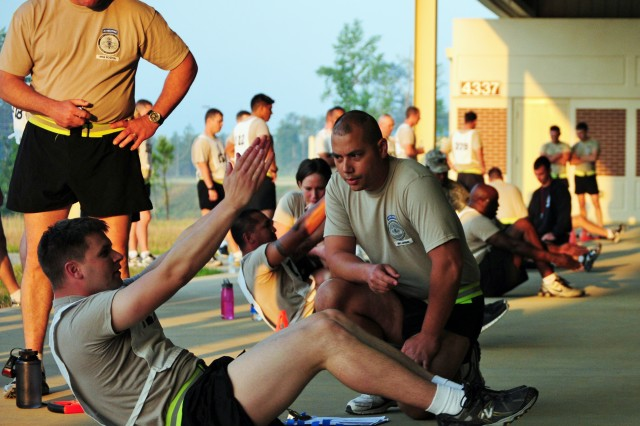 Sgt. Timothy Heater, a medic with the National Guard's Warrior Training Center, completes the rower exercise as part of testing for the Army's new Physical Readiness Test at Fort Benning, Ga., May 10, 2011.