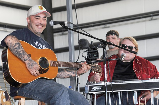 Aaron Lewis, solo country music singer and lead singer for the rock band, Staind, left, smiles at a fan during his solo acoustic concert April 30 at Marshall Army Airfield, Fort Riley. About 1,500 people attended the free concert sponsored by DFMWR.