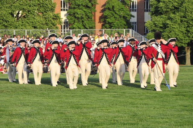 The Fife and Drum Corps, 3d U.S. Infantry Regiment (The Old Guard), performs during Twilight Tattoo on May 11, 2011 at Fort Lesley J. McNair, Washington, D.C. The Fife and Drum Corps wears uniforms dated back to 1781, musicians of that time period wore