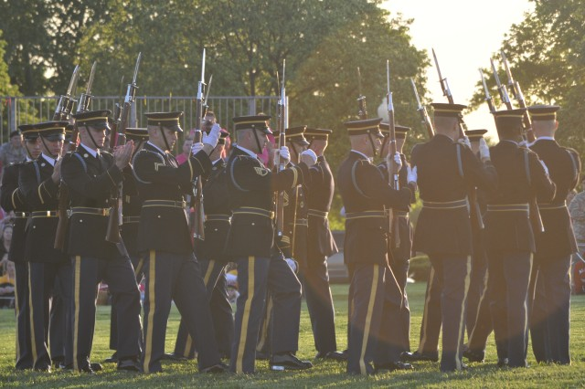 """The United States Army Drill Team, 3d U.S. Infantry Regiment (The Old Guard), performs the """"hat band"""" drill during Twilight Tattoo on May 11, 2011 at Fort Lesley J. McNair, Washington, D.C. (U.S. Army photo by Spc. Devin Kornaus)"""