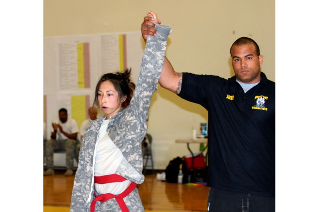 Pfc. Jennifer Jones, 2nd Brigade, 2nd Infantry Division, has her hand held high May 4, 2011, after dominating her opponent during the second annual Joint Base Lewis-McChord, Wash., Combatives Tournament, held May 2-5, 2011, at Soldiers Field House. Jones