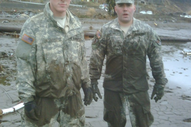 Capt. Erol Munir, D Detachment, 1st Space Company commander, and Sgt. 1st Class Marcus Weiland pause while helping clean up after an earthquake and tsunami devastated Japan in March.