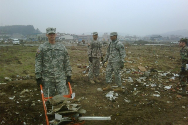 Staff Sgt. Christopher Douglas, Pvt. Jonathan Segarra and Sgt. Vyncent Beasley help clear debris after an earthquake and tsunami devastated Japan in March. All three Soldiers are with the Joint Tactical Ground Station at Misawa Air Base, D Detachment,