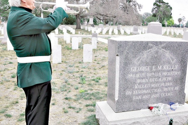 "Retired Col. Jim Baker from The Stinsons Flight No. 2 of the Order of the Daedalians plays ""Taps"" at the gravesite of 2nd Lt. George E.M. Kelly May 10. Kelly died in an aircraft crash at nearby Fort Sam Houston 100 years ago."