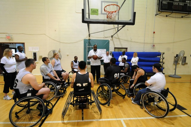 The Wheelchair Basketball team huddles up before training as one of their coaches gives them directions and lays out the plan for the practice. The team is practicing at Fort Carson, Colo., this week in preparation for the Warrior Games, a joint endeavor