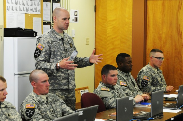 Staff Sgt. Brett Michael, an instructor with the Henry H. Lind Noncommissioned Officer Academy on Joint Base Lewis-McChord, Wash., provokes a little healthy conversation among his Warrior Leader Course students during leadership training at the academy