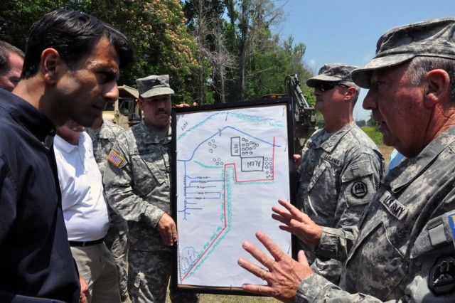 Maj. Gen. Bennett C. Landreneau, Louisiana National Guard adjutant general, briefs Louisiana Governor Bobby Jindal on a project to raise a levee due to potential flooding at the southern end of Krotz Springs, La., May 12, 2011. The Louisiana National