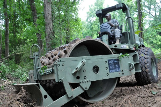 Staff Sgt. Cedric Grimes, Louisiana Guard, operates a compactor at the southern end of Krotz Springs, La., May 12, 2011. The Louisiana Guard is working jointly with local, state and parish officials on a nearly two-mile-long levee that will add one to