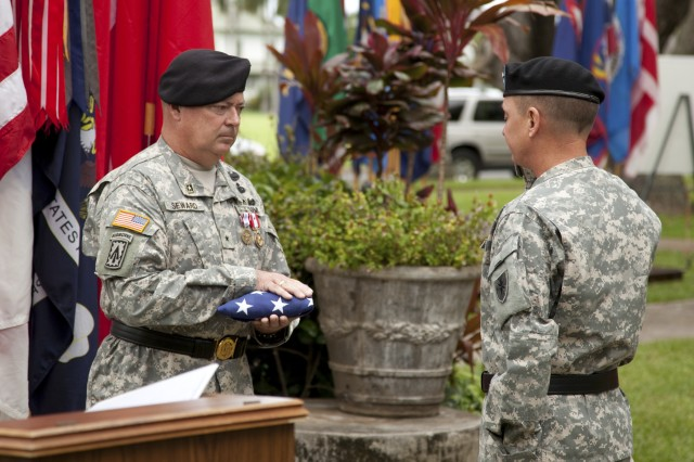 Brig. Gen. John E. Seward (left), deputy commander for United States Army Pacific holds the American flag while Maj. Gen. Michael J. Terry (right), commander of 8th Theater Sustainment Command renders honors. Seward's retirement ceremony was held