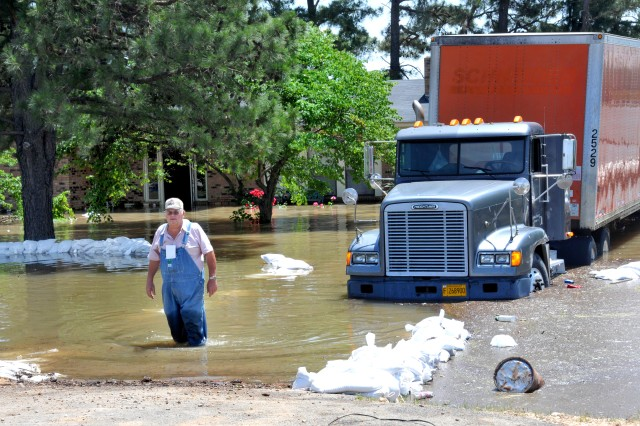 A local resident near Jonesoro, Ark., stands in flood waters after failing in his attempts to hold back the nearby St. Francis River, May 12, 2011.