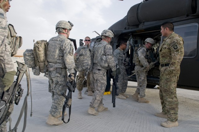 FORWARD OPERATING BASE SPIN BOLDAK, Afghanistan -Soldiers from Bravo Platoon, 1st Squadron, 38th Cavalry Regiment, 525th Battlefield Surveillance Brigade practice boarding a UH-60 Black Hawk helicopter during cold-load training at Forward Operating Base,