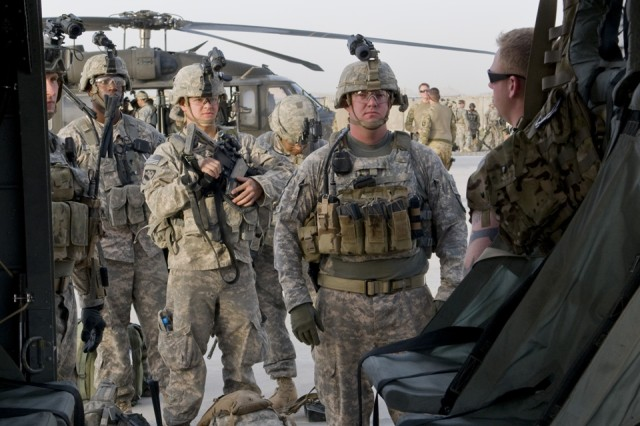 FORWARD OPERATING BASE SPIN BOLDAK, Afghanistan -A crew chief instructs Soldiers from Bravo Platoon, 1st Squadron, 38th Cavalry Regiment, 525th Battlefield Surveillance Brigade on how to safely mount and dismount a UH-60 Black Hawk helicopter while