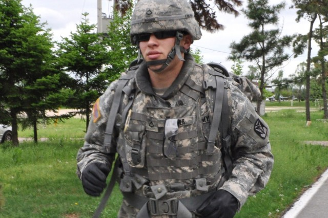 Pfc. Ryan Winner of A Battery, 6-52nd Air Defense Artillery Battalion, making strides to become Eighth Army's top Soldier during a training ruck march session at Suwon Air Base, South Korea May 12.