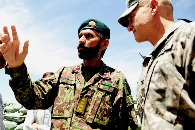 Afghan National Army Col. Malang Shah Chamcanai, Regional Military Training Center-Gardez commander, speaks with Army Col. Ronald Metternich, Regional Support Command - East commander, about ANA training progressions during a battlefield circulation
