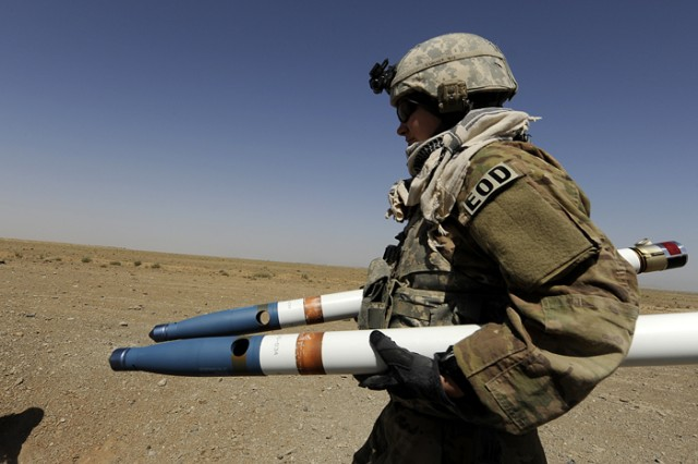 KANDAHAR PROVINCE, Afghanistan-U.S. Air Force Staff Sgt. Emily Walker, an explosive ordnance disposal technician, deployed to the 466th Air Expeditionary Squadron, Kandahar Airfield, Afghanistan, transports two 2.75 inch rockets for an ammunition