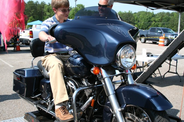 Jeff Hayne, a Harley sales associate, explains details of his motorcycle display to Matthew Smith, Concepts Analysis Lab, U.S. Army Space and Missile Defense Command/Army Forces Strategic Command during the command's joint Safety Day with the