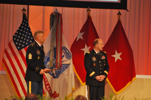 LTG Mitchell H. Stevenson, Deputy Chief of Staff of the Army for Logistics, and Sergeant Major of the Army Raymond F. Chandler III, prepare to present a plaque to a winning unit at the Combined Logistics Excellence Awards Ceremony.