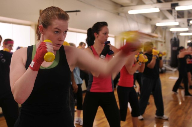 Sgt. Cassandra Owen, an Army Reserve signal support systems specialist, 1395th Transportation Terminal Brigade, Schwab Reserve Center, practices her punching skills in an all women's boxing class at McVeigh Sports and Fitness Center on Joint Base