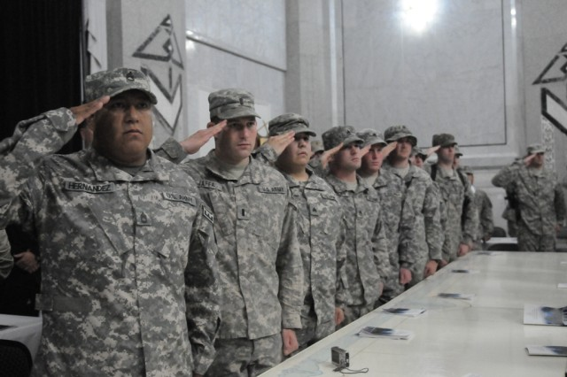 Service members from Joint Task Force Troy, United States Forces - Iraq, render their salute honoring their fallen explosive ordinance disposal technicians, from World War II to present, during a memorial service hosted by the USF-I JTFT in Al Faw