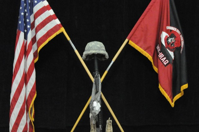 The traditional boots, dog tags, m-16 rifle and kevlar is displayed during a memorial service hosted by the USF-I JTFT in honor of the fallen EOD technicians, in Al Faw Palace, Camp Victory, May 7.