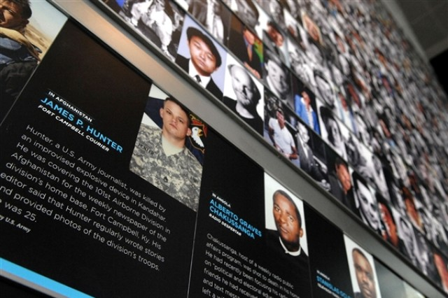 The photograph and short biography of Army Staff Sgt. James Hunter is on display near the Journalists Memorial at the Newseum in Washington, D.C. Hunter was among 77 fallen journalists honored at the 2011 re-dedication of the memorial, May 16, 2011.