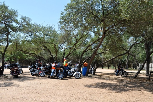 IMCOM motorycle riders rest in the shade after a three-hour ride through the Texas Hill Country.