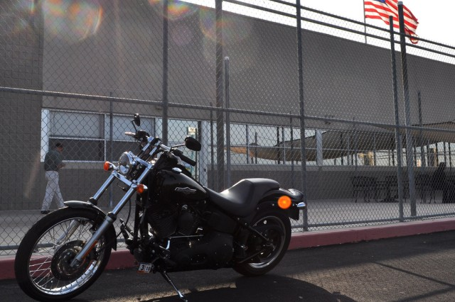 A Harley waits in front of the IMCOM HQ leased space as the American flag flies in the background.