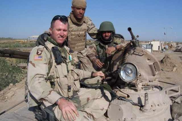 Staff Sgt. Sean Cornelison takes a break from a mission with Iraqi counterparts during Operation Iraqi Freedom. Cornelison, an armor crewman currently serving with Headquarters and Headquarters Company, 1st Advise and Assist Task Force, 1st Infantry