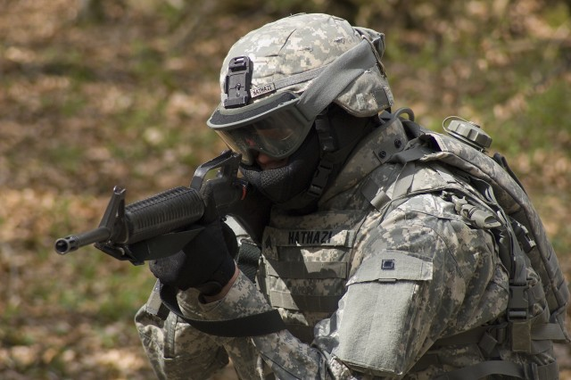 Sgt. Mark Hathazi provides cover fire during Alpha Detachment's field training exercise in Stuttgart, Germany, April 11-15.