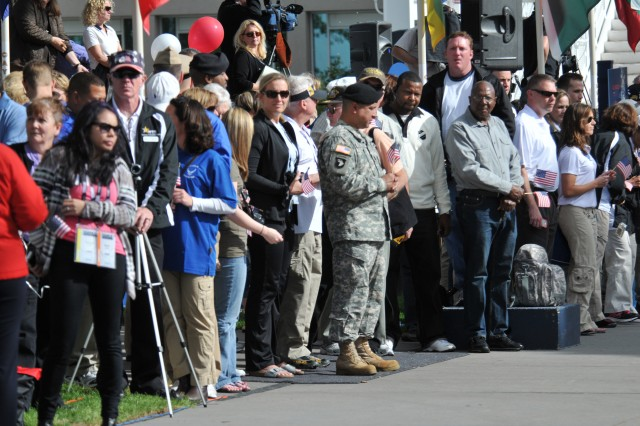 A crowd gathered to wave flags and cheer on each team, regardless of which branch of service they represented, as they entered through the Olympic Path. The Warrior Games is a joint endeavor between the U.S. Olympic Committee and the U.S. Department of