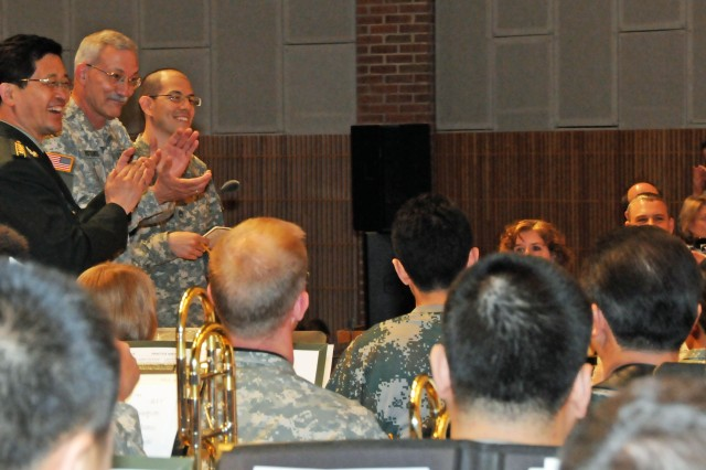 """The U.S. Army Band """"Pershing's Own"""" conductor Col. Thomas Rotondi, Jr., stands with  the Military Band of the People's Liberation Army of China conductor Senior Col. Yu Hai prior to a rehearsal at Brucker Hall at Joint Base"""