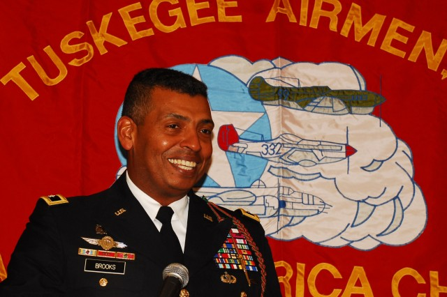 Maj. Gen. Vincent Brooks, commanding general of the 1st Inf. Div. and Fort Riley, applauds the contributions of the Tuskegee Airmen May 14 during the Heart of America Chapter of Tuskegee Airmen, Inc. Charter Dinner in Overland Park, Kan. The Tuskegee