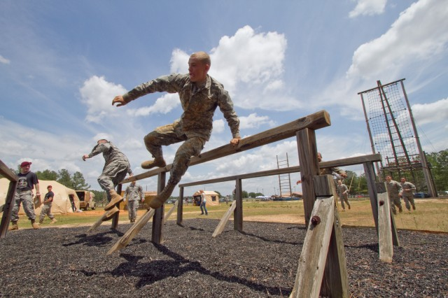 A paratrooper with the 82nd Airborne Division's 3rd Brigade Combat Team leaps a hurdle during a team obstacle course competition May 16, 2011, at Fort Bragg, N.C.  The competition is part of All American Week, five days of celebration and